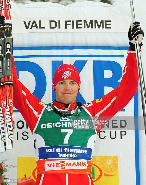 US Bill Demong celebrates on the podium after winning the Gundersen Combined competition event of the FIS Nordic Combined World Cup in Alpe's Cermins...