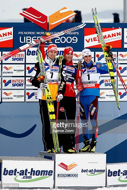 Bill Demong of USA Bjoern Kircheisen of Germany Jason Lamy Chappuis of france celebrate on the podium during the HS134 Ski Jumping of the Nordic...