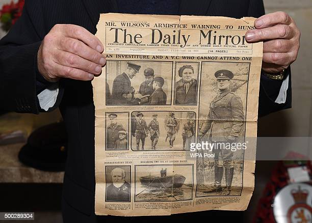 Bill Edisbury whose second cousin James Neville Marshall received the Victoria Cross in the First World War holds the front page of The Daily Mirror...