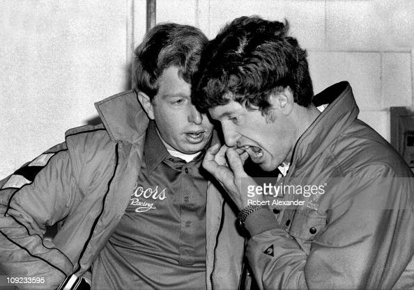 Bill Elliott right talks with his brother Ernie in the Daytona International Speedway garage prior to the start of the 1986 Daytona 500 on February...
