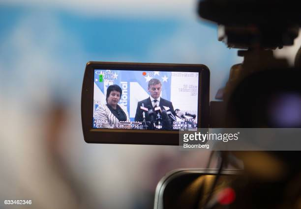 Bill English New Zealand's prime minister right and Paula Bennett New Zealand's deputy prime minister are seen on the screen of a video camera as...