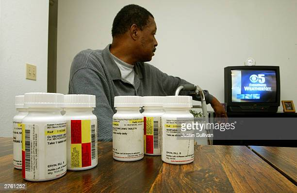 Bill Ervin watches television as his medications sit on a table in his room at the Salvation Army Senior Center November 25 2003 in Richmond...