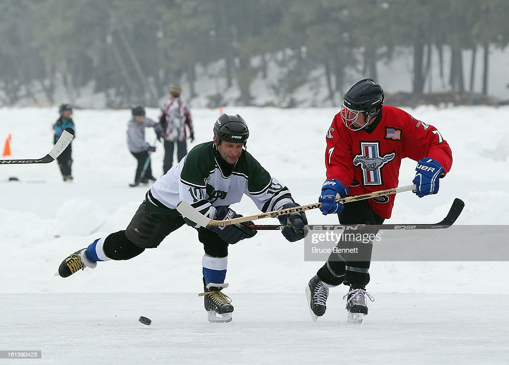 Bill Ford (R), Chairman of the Ford Motor Company competes in the championship game at the 2013 USA Hockey Pond Hockey National Championships on February 10, 2013 in Eagle River, Wisconsin. The three day tournament features 2,400 participants from 30 states playing a round robin tournament on 28 rinks laid out on Dollar Lake.