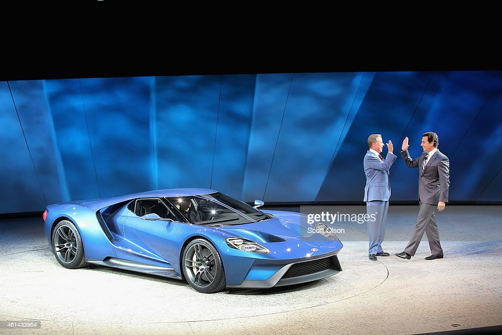 Bill Ford (L), Executive Chairman of Ford Motor Company, and Mark Fields, President and Chief Executive Officer of Ford Motor Company, celebrate the launch of the Ford GT at the North American International Auto Show (NAIAS) on January 12, 2015 in Detroit, Michigan. More than 5000 journalists from around the word will see approximately 45 new vehicles unveiled during the 2015 NAIAS, which opens to the public January 17 and concludes January