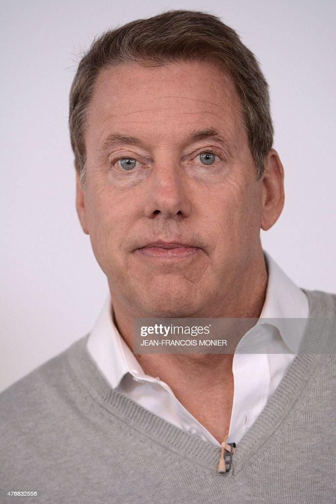 Bill Ford greatgrand son of Henri Ford and chairman of 'Ford Motor Company' poses next to a Ford GT after a press conference ahead of the start of...