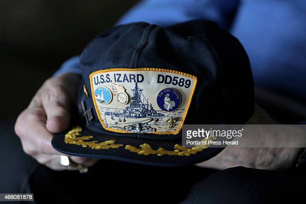 Bill Gardner holds a cap with the insignia of the USS Izard DD589 the destroyer he served on during World War II Wed March 4 2015 Gardner now 90...