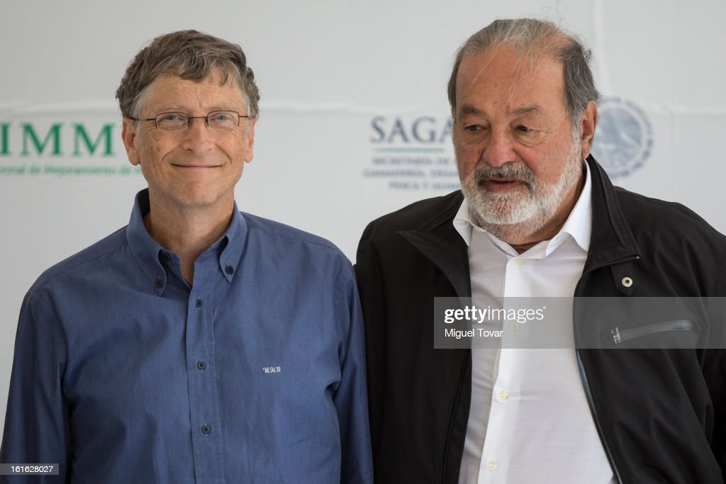Bill Gates and Carlos Slim pose after a press conference at the CIMMYT on February 13, 2013 in Texcoco, Mexico. Gates and Slim announce a collaboration of their foundations in grain technology and agriculture development.