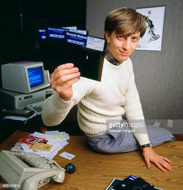 Bill Gates CEO of Microsoft holds a Windows 10 floppy discs soon after its release