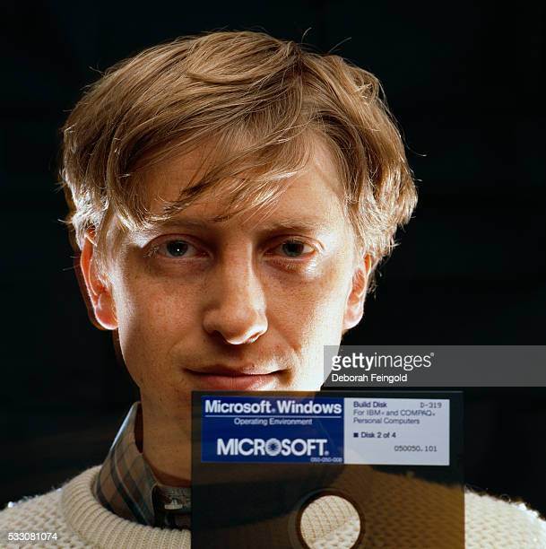 Bill Gates CEO of Microsoft holds a Windows 10 floppy disk soon after its release