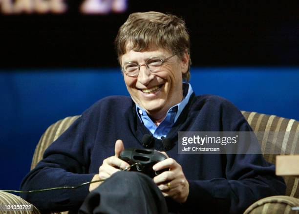Bill Gates chairman and chief software architect of Microsoft Corp laughs as he plays an Xbox car racing game against talk show host Conan O'Brien as...