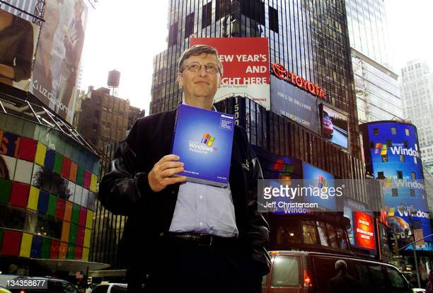 Bill Gates Chairman and Chief Software Architect of Microsoft holds a copy of Microsoft's Windows XP in New York's Times Square October 25 2001...