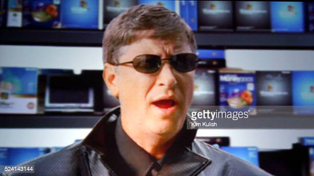 Bill Gates Chairman and Chief Software Architect of Microsoft performs in a pretaped spoof of 'The Matrix' during the opening Keynote Speech at...