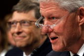 Bill Gates cofounder and cochair of the Bill Melinda Gates Foundation and former US President Bill Clinton testify before the Senate Foreign...