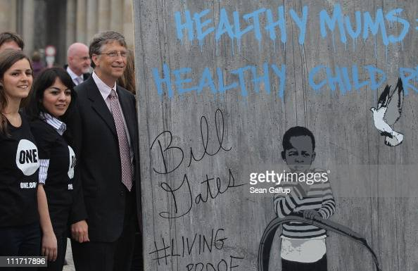 Bill Gates founder of Microsoft and now philanthropist poses with Oneorg charity volunteers at Pariser Platz square during a brief stop at...