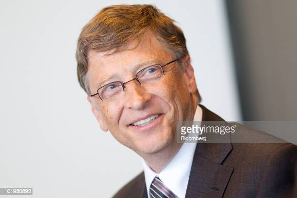 Bill Gates founder of Microsoft Corp smiles during an American Energy Innovation Council news conference at the Newseum in Washington DC US on...