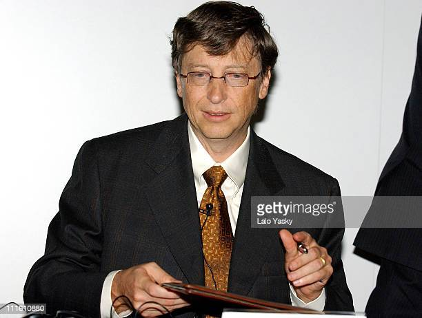 Bill Gates Microsoft CEO and Miguel Carballeda director of Spain's National Blinds Organization sign a cooperation agreement to develop an...