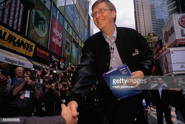 Bill Gates Microsoft's Chairman and Chief Software Architect shakes hands in Times Square during the Windows XP launch