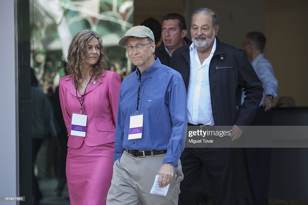 Bill Gates, Sara Boettiger, CIMMYT representative and Carlos Slim arrive at a press conference at the CIMMYT on February 13, 2013 in Texcoco, Mexico. Gates and Slim announce a collaboration of their foundations in grain technology and agriculture development.