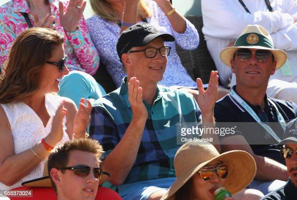 Bill Gates watches Roger Federer of Switzerland as he plays against Stanislas Wawrinka of Switzerland in the mens final during day fourteen of the...