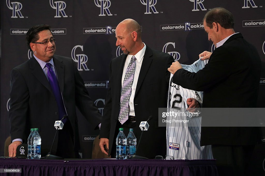 Bill Geivett Senior Vice President of Scouting and Player Developement/Assistant General Manager of the Colorado Rockies presents Walt Weiss as manager of the Rockies along with Dick Monfort Owner/Chairman and CEO of the Rockies during a press conference at Coors Field on November 9, 2012 in Denver, Colorado.