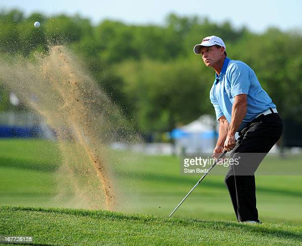 Bill Glasson hits from a bunker on the first hole during the final round of the Legends Division at the Liberty Mutual Insurance Legends of Golf at...