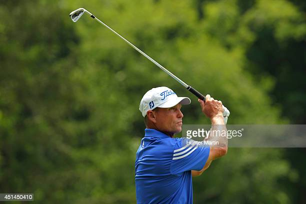 Bill Glasson hits his tee shot on the fifth hole during the final round of the Constellation Senior Players Championship at Fox Chapel Golf Club on...