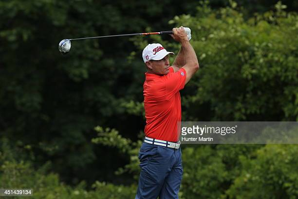 Bill Glasson hits his tee shot on the seventh hole during the third round of the Constellation Senior Players Championship at Fox Chapel Golf Club on...