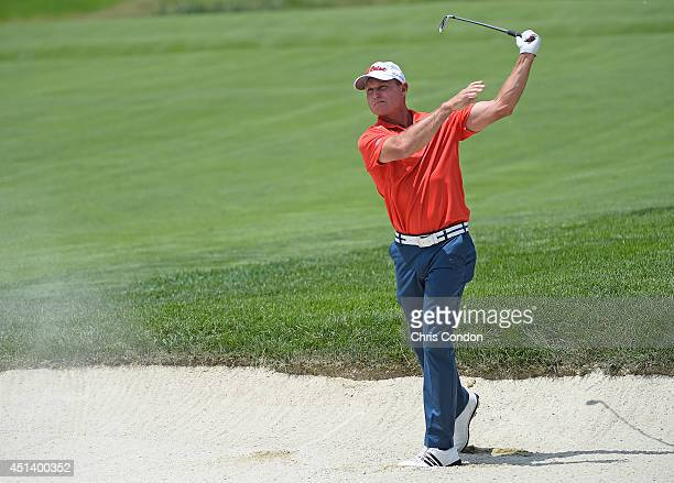 Bill Glasson plays from a bunker on the 8th hole during the third round of the Constellation SENIOR PLAYERS Championship at Fox Chapel Golf Club on...
