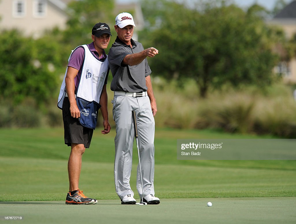<a gi-track='captionPersonalityLinkClicked' href=/galleries/search?phrase=Bill+Glasson&family=editorial&specificpeople=2130557 ng-click='$event.stopPropagation()'>Bill Glasson</a> studies his putt on the third hole during the second round of the Legends Division at the Liberty Mutual Insurance Legends of Golf at The Westin Savannah Harbor Golf Resort & Spa on April 27, 2013 in Savannah, Georgia.