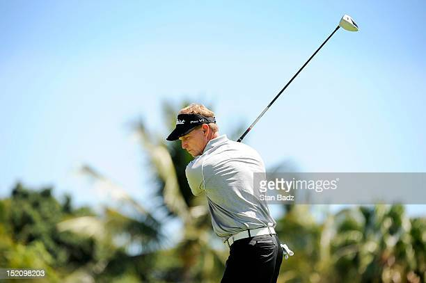 Bill Glasson takes a practice swing on the first hole during the final round of the Pacific Links Hawaii Championship at Kapolei Golf Course on...