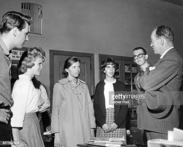 Bill Grant talks to South high young Democratic club members Left to right Randy Sylvester Dennise Van Portfliet Cozette Medill Judy Holmes and Bill...