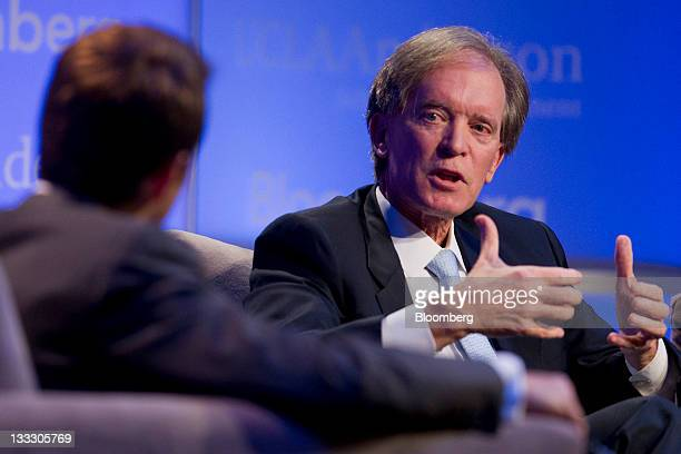 Bill Gross cochief investment officer of Pacific Investment Management Co right talks to host Erik Schatzker during an alumni event hosted by UCLA...