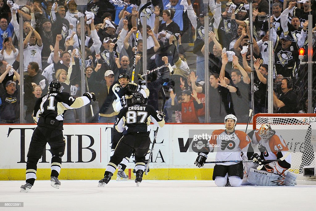 Bill Guerin Evgeni Malkin and Sidney Crosby all of the Pittsburgh Penguins celebrate Guerin's overtime power play goal against the Philadelphia...