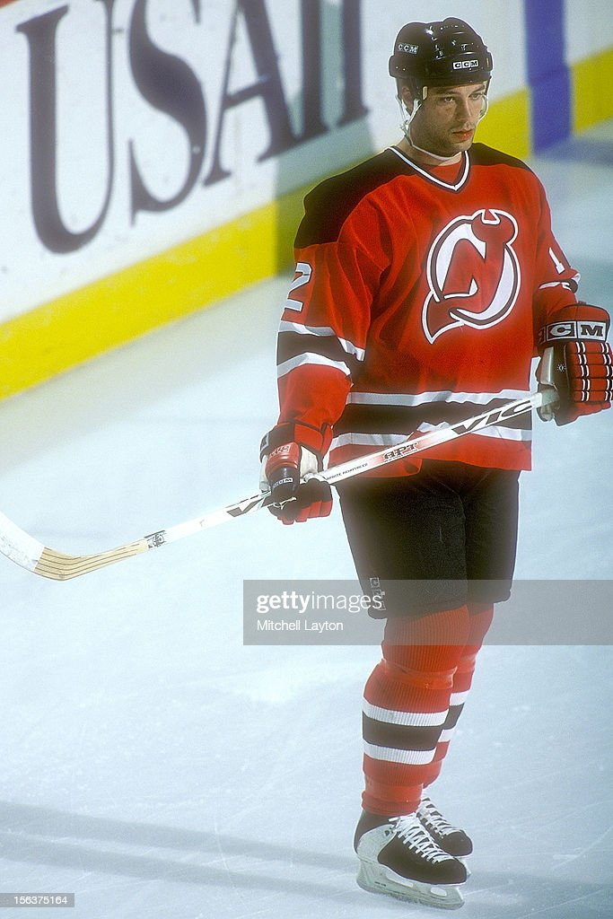 Bill Guerin of the New Jersey Devils looks on before a hockey game against the Washington Capitals on April 1 1997 at USAir Arena in Landover...