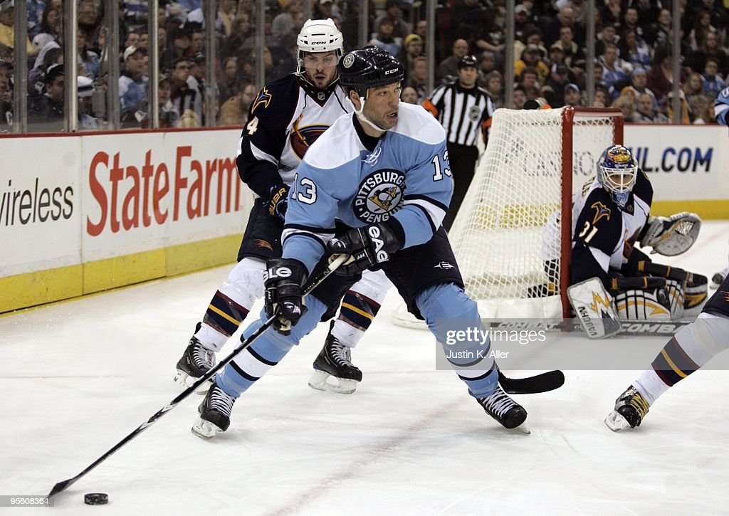Bill Guerin of the Pittsburgh Penguins looks to make a pass against the Atlanta Thrashers at Mellon Arena on January 5 2010 in Pittsburgh...