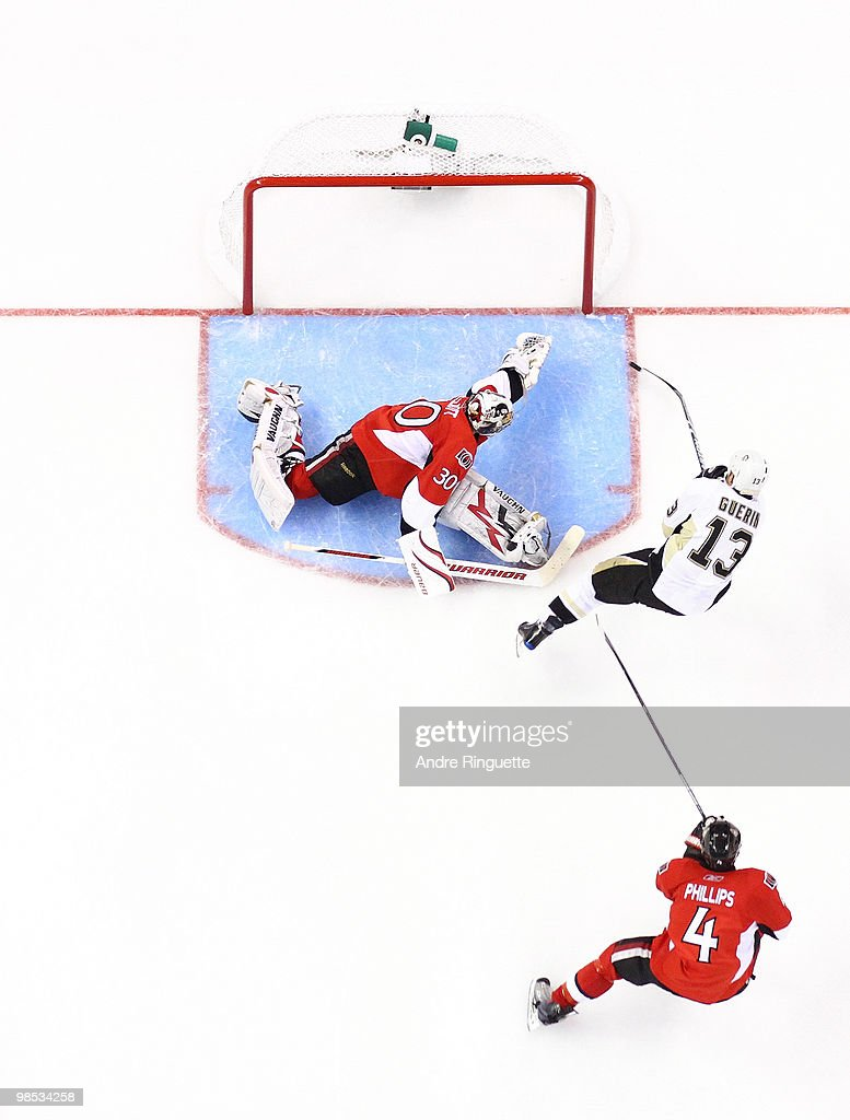 Bill Guerin of the Pittsburgh Penguins shoots the puck past the outstretched glove of Brian Elliott of the Ottawa Senators for a third period goal in...