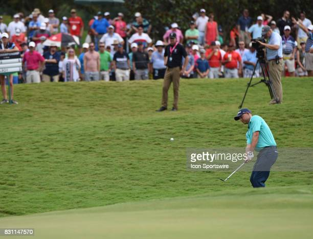 Bill Haas chips onto the 7th green during the final round of the PGA Championship on August 13 2017 at Quail Hollow Golf Club in Charlotte NC
