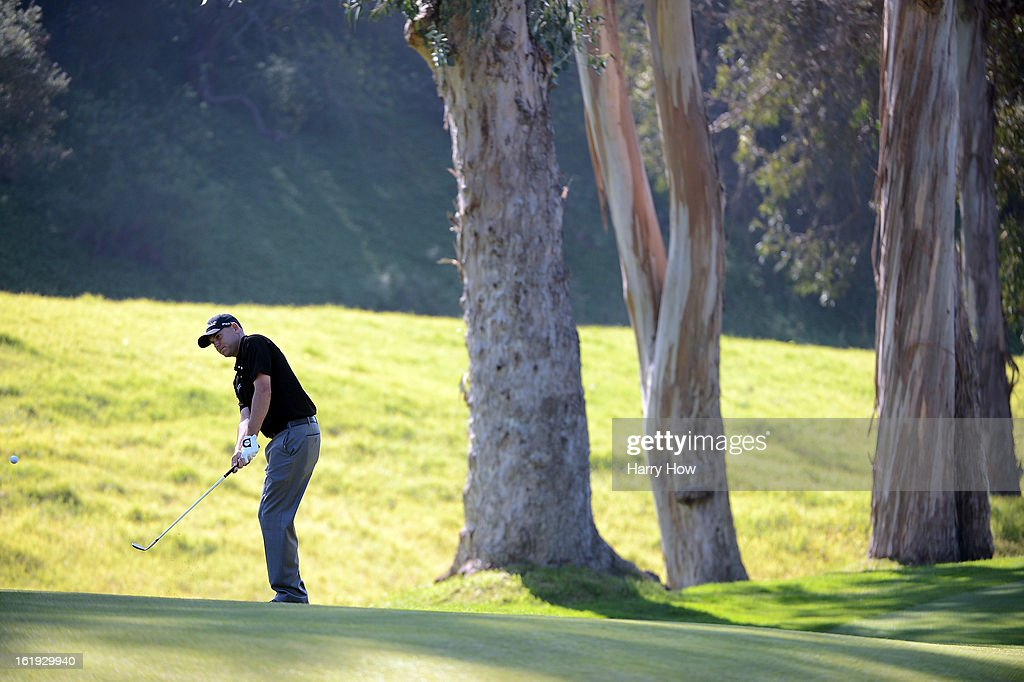 Bill Haas chips to the seventh green during the final round of the Northern Trust Open at the Riviera Country Club on February 17, 2013 in Pacific Palisades, California.