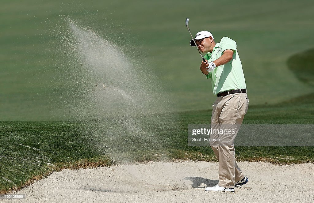 Bill Haas hits a bunker shot on the first hole during the third round of the Shell Houston Open at the Redstone Golf Club on March 30, 2013 in Humble, Texas.