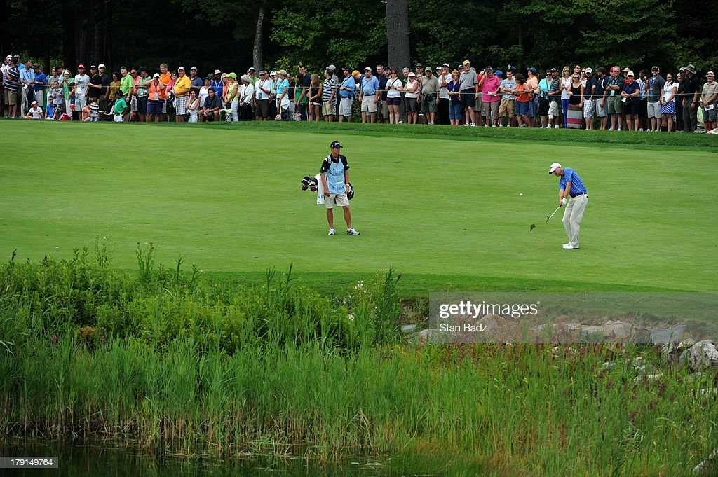 <a gi-track='captionPersonalityLinkClicked' href=/galleries/search?phrase=Bill+Haas&family=editorial&specificpeople=646978 ng-click='$event.stopPropagation()'>Bill Haas</a> hits a shot to the second green during the second round of the Deutsche Bank Championship at TPC Boston on August 31, 2013 in Norton, Massachusetts.