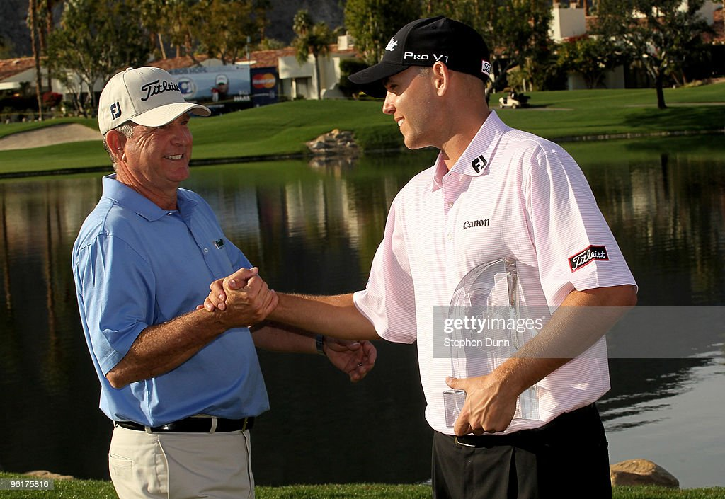 <a gi-track='captionPersonalityLinkClicked' href=/galleries/search?phrase=Bill+Haas&family=editorial&specificpeople=646978 ng-click='$event.stopPropagation()'>Bill Haas</a> (R) is congratulated by father and former tournament champion <a gi-track='captionPersonalityLinkClicked' href=/galleries/search?phrase=Jay+Haas&family=editorial&specificpeople=204209 ng-click='$event.stopPropagation()'>Jay Haas</a> on the 18th green after Bill's victory at the Palmer Private course at PGA West during the final round of the Bob Hope Classic on January 25, 2010 in La Quinta, California.