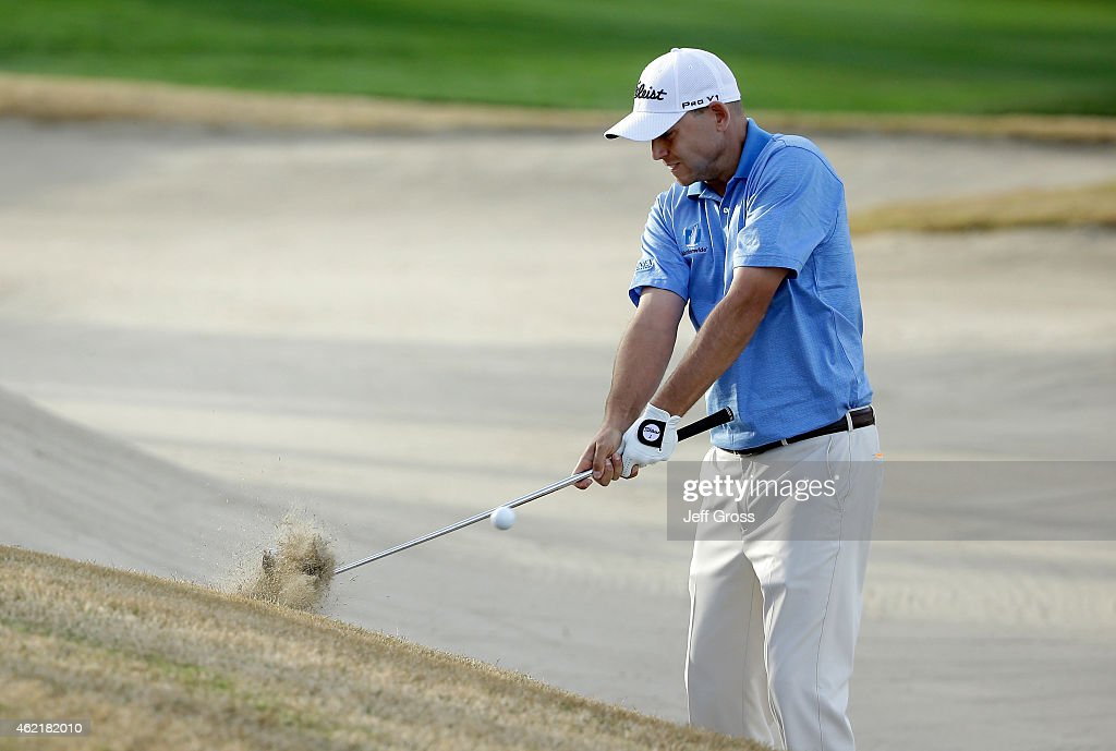 Bill Haas of the United States plays his second shot from the edge of the bunker on the 18th hole during the final round of the Humana Challenge in...
