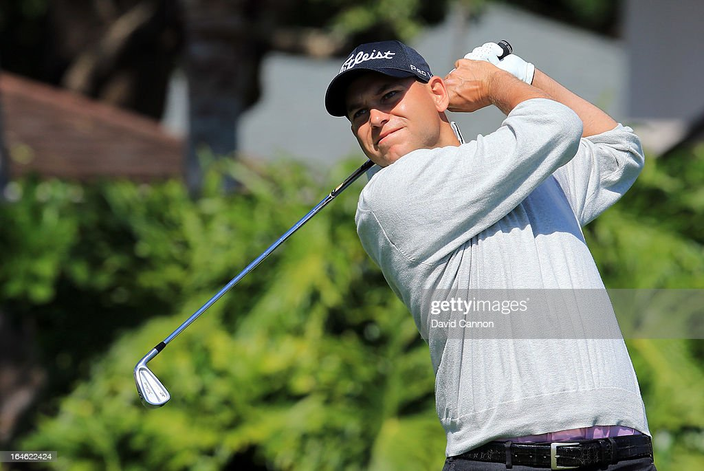 <a gi-track='captionPersonalityLinkClicked' href=/galleries/search?phrase=Bill+Haas&family=editorial&specificpeople=646978 ng-click='$event.stopPropagation()'>Bill Haas</a> of the United States plays his tee shot at the par 4, 13th hole during the final round of the 2013 Arnold Palmer Invitational Presented by Mastercard at Bay Hill Golf and Country Club on March 25, 2013 in Orlando, Florida.
