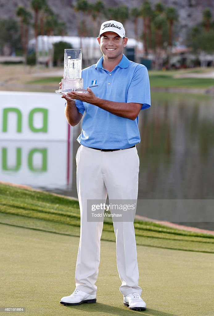 <a gi-track='captionPersonalityLinkClicked' href=/galleries/search?phrase=Bill+Haas&family=editorial&specificpeople=646978 ng-click='$event.stopPropagation()'>Bill Haas</a> of the United States poses with the trophy after winning the final round of the Humana Challenge in partnership with The Clinton Foundation on the Arnold Palmer Private Course at PGA West on January 25, 2015 in La Quinta, California.