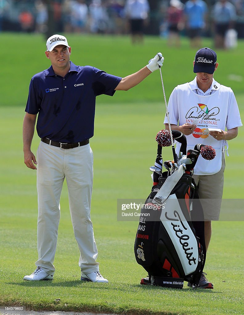 Bill Haas of the United States pulls his club before playing his second shot at the par 4, 1st hole with his brother Jay Haas Jr as his caddie during the third round of the 2013 Arnold Palmer Invitational Presented by Mastercard at Bay Hill Golf and Country Club on March 23, 2013 in Orlando, Florida.