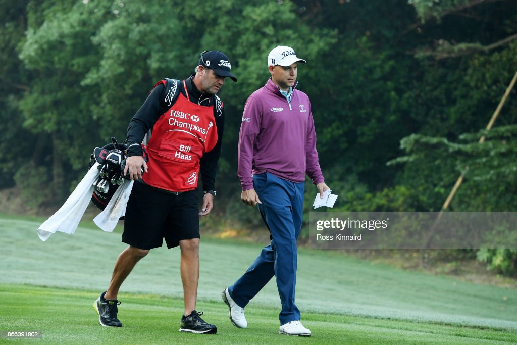 Bill Haas of the United States walks with his caddie Lance Bennett during the pro-am prior to the WGC - HSBC Champions at Sheshan International Golf Club on October 25, 2017 in Shanghai, China.