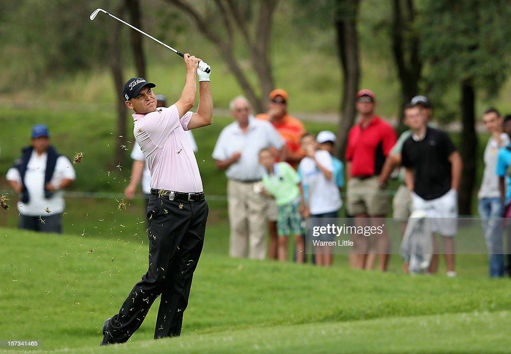 Bill Haas of the USA plays his second shot into the first green during the final round of the Nedbank Golf Challenge at the Gary Player Country Club on December 2, 2012 in Sun City, South Africa.