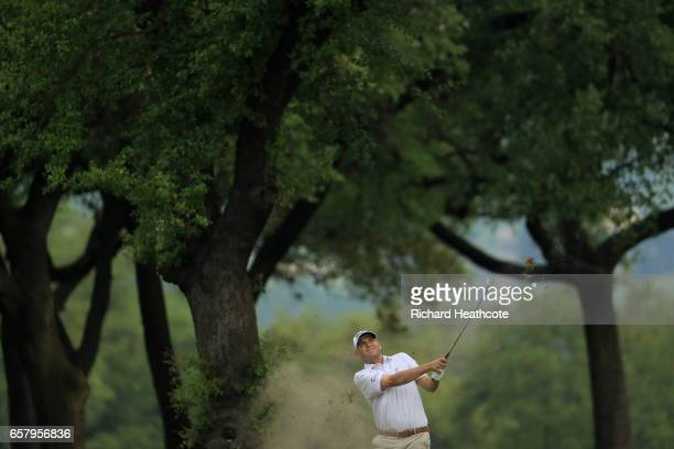 Bill Haas plays a shot on the 1st hole of his match during the semifinals of the World Golf ChampionshipsDell Technologies Match Play at the Austin...