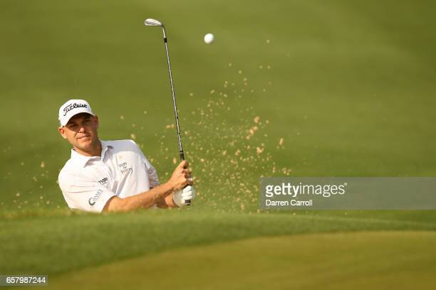 Bill Haas plays a shot out of a bunker on the 3rd hole of his match during the semifinals of the World Golf ChampionshipsDell Technologies Match Play...