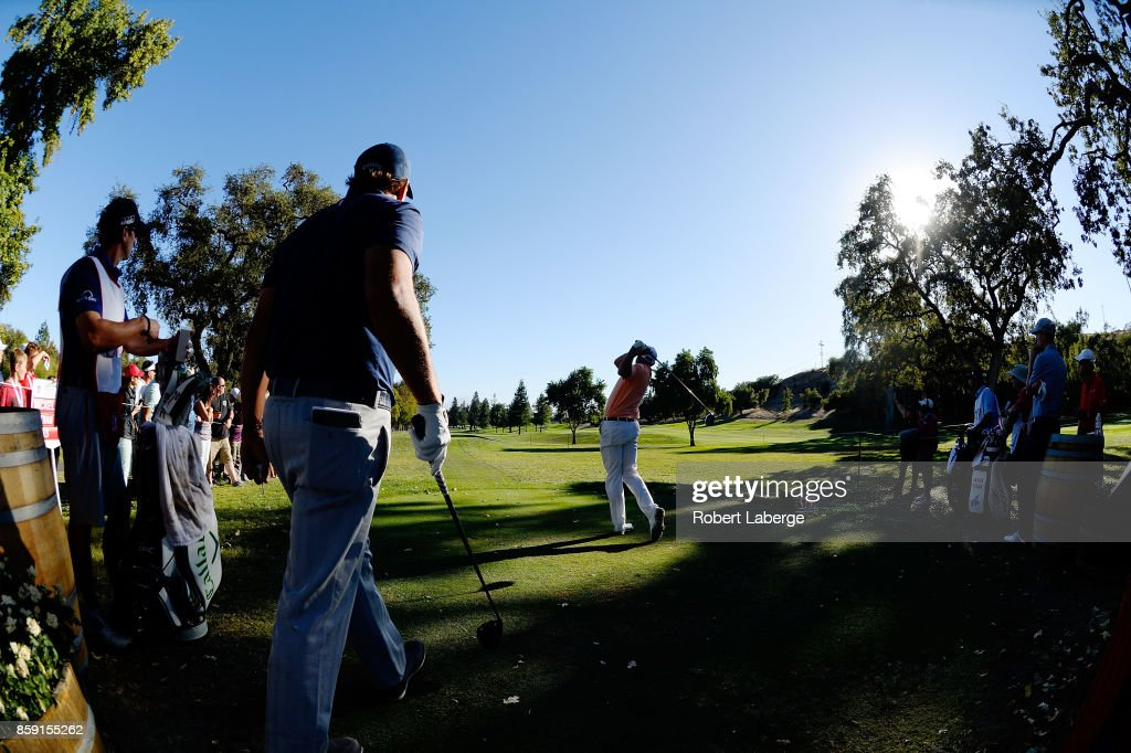 Bill Haas plays his shot from the 16th tee as Phil Mickelson looks on during the final round of the Safeway Open at the North Course of the Silverado Resort and Spa on October 8, 2017 in Napa, California.